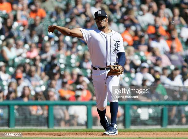 Third baseman Jeimer Candelario of the Detroit Tigers throws out Whit Merrifield of the Kansas City Royals at first base during the fourth inning at...