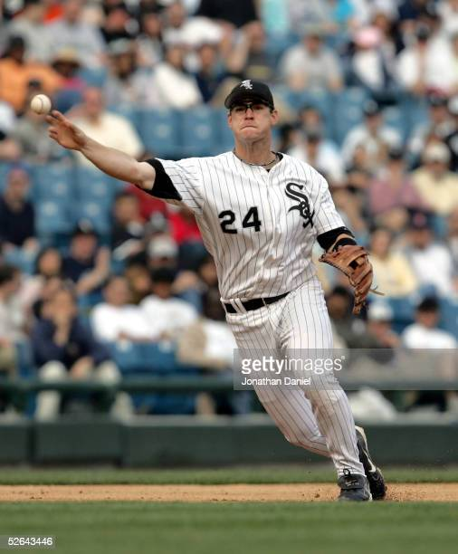 Third baseman Joe Crede of the Chicago White Sox throws the ball to first for an out against the Seattle Mariners on April 17 2005 at US Cellular...