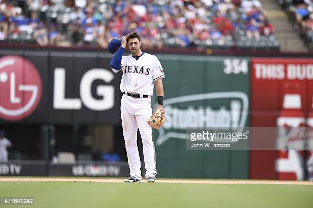 Third baseman Joey Gallo of the Texas Rangers stands at his position in the field during a time out in the game against the Minnesota Twins at Globe...