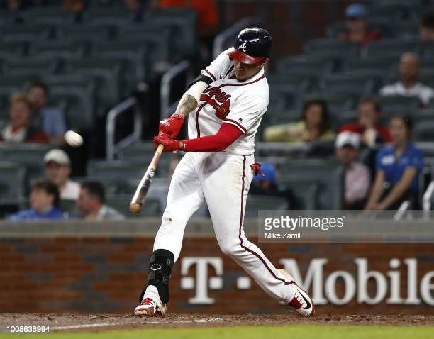 Third baseman Johan Camargo of the Atlanta Braves hits a solo home run in the sixth inning during the game against the Miami Marlins at SunTrust Park...
