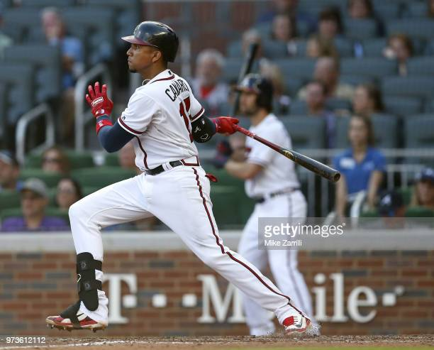 Third baseman Johan Camargo of the Atlanta Braves swings during the game against the Washington Nationals at SunTrust Park on June 2, 2018 in...