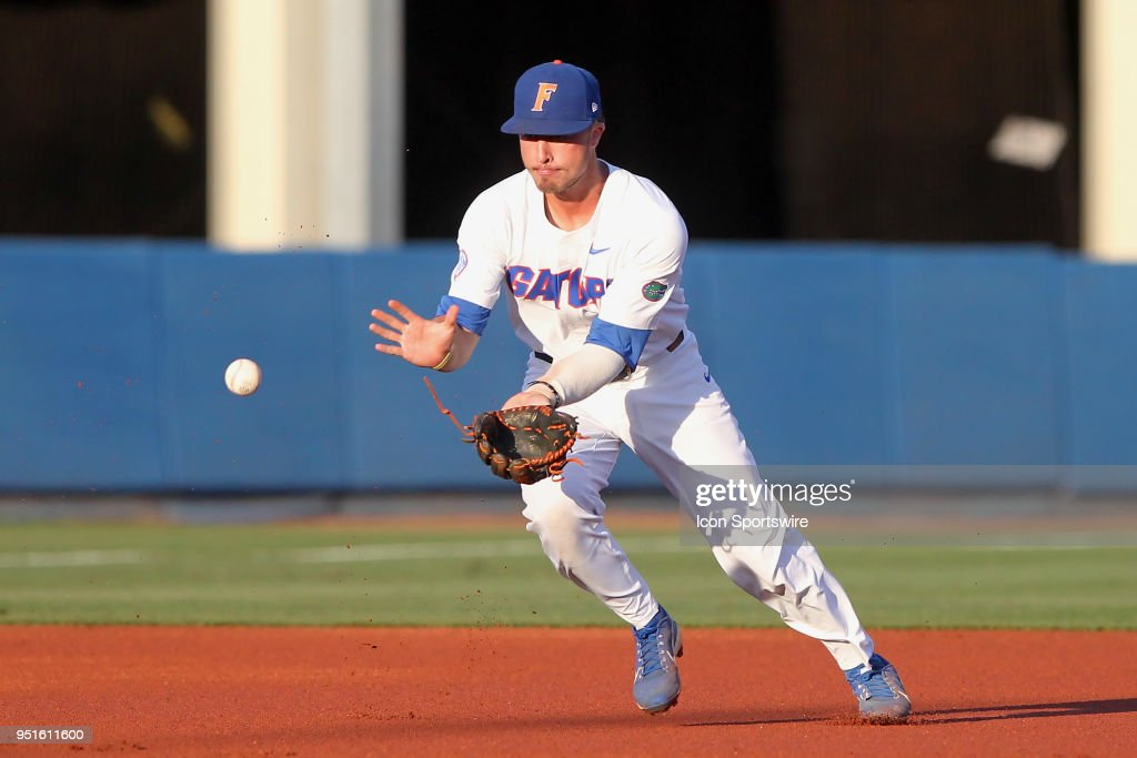 Third baseman Jonathan India (6) of the Gators fields a ground ball during the college baseball game between the No. 22 Auburn Tigers and the No. 1 Florida Gators on April 26, 2018 at Alfred A. McKethan Stadium in Gainesville, Florida.