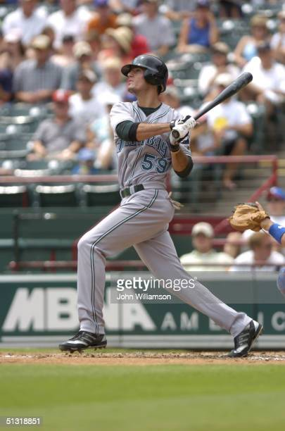 Third baseman Jorge Cantu of the Tampa Bay Devil Rays bats during the MLB game against the Texas Rangers at Ameriquest Field in Arlington on August...