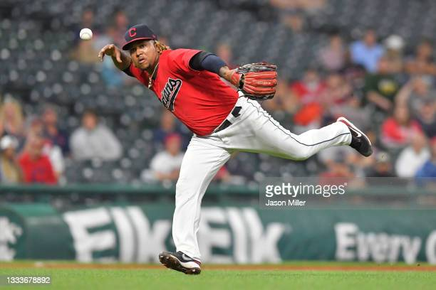 Third baseman Jose Ramirez of the Cleveland Indians bobbles a barehanded catch on a ground ball hit by Elvis Andrus of the Oakland Athletics during...