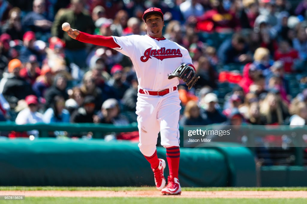 Third baseman Jose Ramirez #11 of the Cleveland Indians throws out Robinson Cano #22 of the Seattle Mariners at first during the seventh inning at Progressive Field on April 29, 2018 in Cleveland, Ohio.