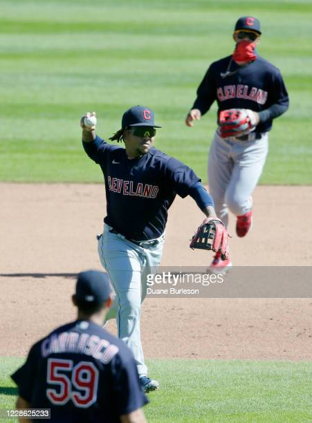 Third baseman Jose Ramirez of the Cleveland Indians with Francisco Lindor backing up on the play throws out Jorge Bonifacio of the Detroit Tigers at...