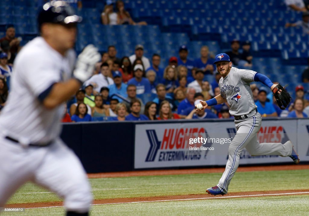 Third baseman Josh Donaldson #20 of the Toronto Blue Jay makes an attempt on the single by Wilson Ramos #40 of the Tampa Bay Rays during the third inning of a game on August 23, 2017 at Tropicana Field in St. Petersburg, Florida.