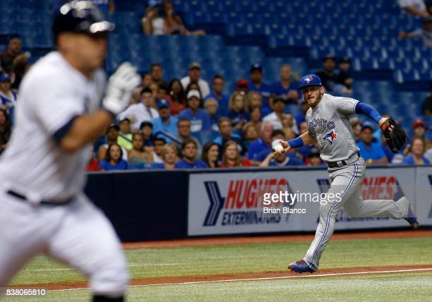 Third baseman Josh Donaldson of the Toronto Blue Jay makes an attempt on the single by Wilson Ramos of the Tampa Bay Rays during the third inning of...