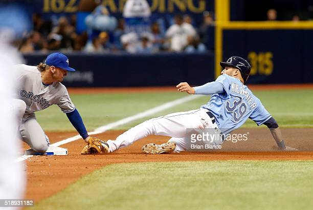 Third baseman Josh Donaldson of the Toronto Blue Jays catches Kevin Kiermaier of the Tampa Bay Rays attempting to steal third base to end the fourth...