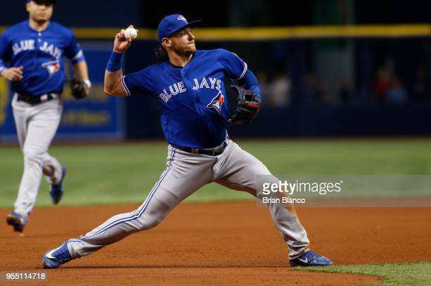 Third baseman Josh Donaldson of the Toronto Blue Jays fields the ground out by Johnny Field of the Tampa Bay Rays during the fourth inning of a game...
