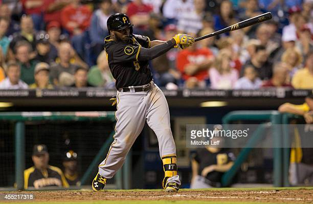 Third baseman Josh Harrison of the Pittsburgh Pirates hits an RBI double in the top of the sixth inning against the Philadelphia Phillies on...