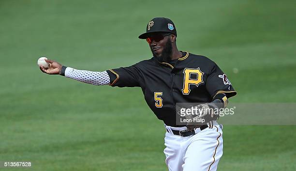 Third baseman Josh Harrison of the Pittsburgh Pirates makes the throw to first base during the first inning of the Spring Training Game against the...