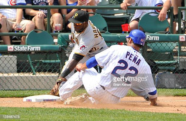 Third baseman Josh Harrison of the Pittsburgh Pirates retires Carlos Pena of the Chicago Cubs after Marlon Byrd hit a ground ball during the fifth...