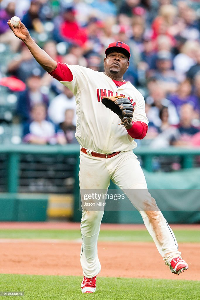 Third baseman Juan Uribe #4 of the Cleveland Indians throws out Christian Colon #24 of the Kansas City Royals to end the top of of the eighth inning at Progressive Field on May 7, 2016 in Cleveland, Ohio.