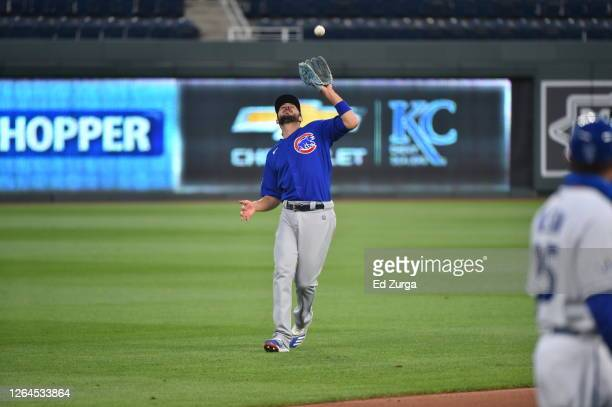 Third baseman Kris Bryant of the Chicago Cubs catches a foul ball against the Kansas City Royals at Kauffman Stadium on August 5, 2020 in Kansas...