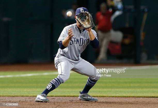 Third baseman Luis Urias of the San Diego Padres plays a ball hit by Adam Jone of the Arizona Diamondbacks during the first inning of an MLB game at...