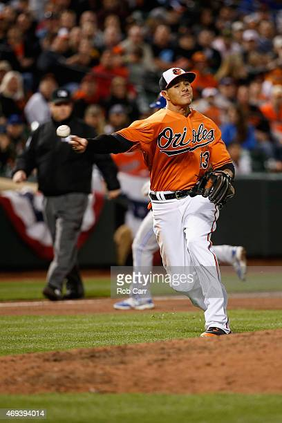 Third baseman Manny Machado of the Baltimore Orioles fields a grounder hit by Danny Valencia of the Toronto Blue Jays for the second out of the ninth...