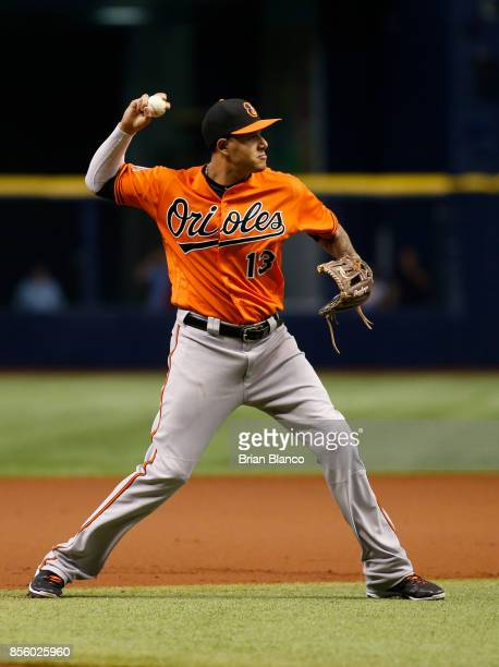 Third baseman Manny Machado of the Baltimore Orioles fields the ground out by Wilson Ramos of the Tampa Bay Rays to end the first inning of a game on...