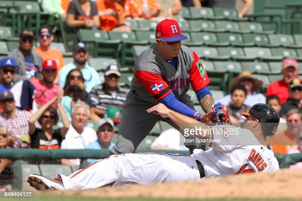 Third baseman Manny Machado of the Dominican Republic applies the tag upon regular season team mate Chris Davis of the Orioles for the out during the...