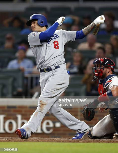Third baseman Manny Machado of the Los Angeles Dodgers hits an RBI single in the ninth inning during the game against the Atlanta Braves at SunTrust...