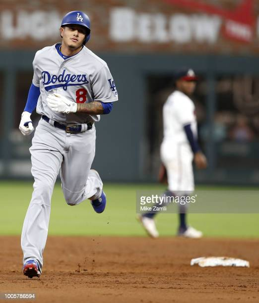Third baseman Manny Machado of the Los Angeles Dodgers runs past second base after hitting a solo home run in the sixth inning during the game...