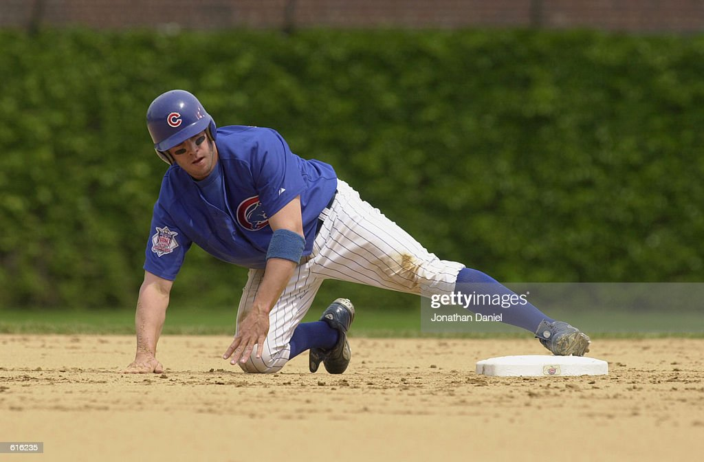 Third baseman Mark Bellhorn #28 of the Chicago Cubs picks himself up after stealing second base during the MLB game against the Pittsburgh Pirates at Wrigley Field in Chicago, Illinois on May 23, 2002. The Cubs won 11-6.