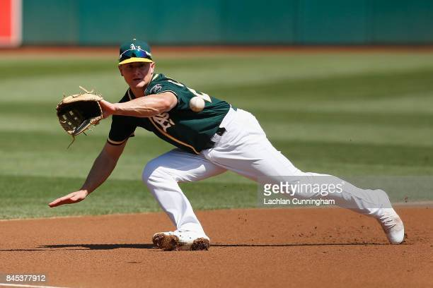 Third baseman Matt Chapman of the Oakland Athletics is unable to field a ball hit by Jose Altuve of the Houston Astros in the first inning at Oakland...