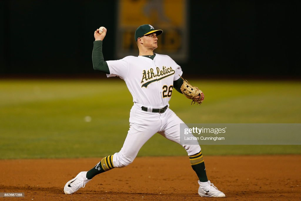 Third baseman Matt Chapman #26 of the Oakland Athletics throws to first base to get the out of Elvis Andrus #1 of the Texas Rangers in the sixth inning at Oakland Alameda Coliseum on September 23, 2017 in Oakland, California.