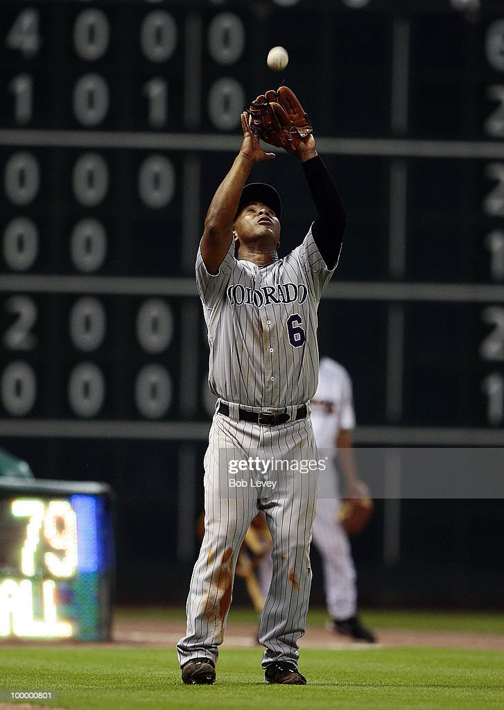 Third baseman Melvin Mora #6 of the Colorado Rockies makes a catch in foul territory against the Houston Astros at Minute Maid Park on May 19, 2010 in Houston, Texas.