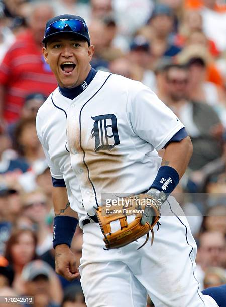 Third baseman Miguel Cabrera of the Detroit Tigers reacts after turning a double play on Carlos Santana of the Cleveland Indians at third base and...