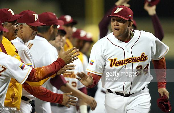 Third baseman Miguel Cabrera of Venezuela is greeted by teammates after being introduced prior to taking on Italy in the first round of the World...