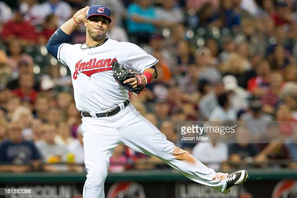 Third baseman Mike Aviles of the Cleveland Indians throws out Brandon Laird of the Houston Astros at first base during the seventh inning at...