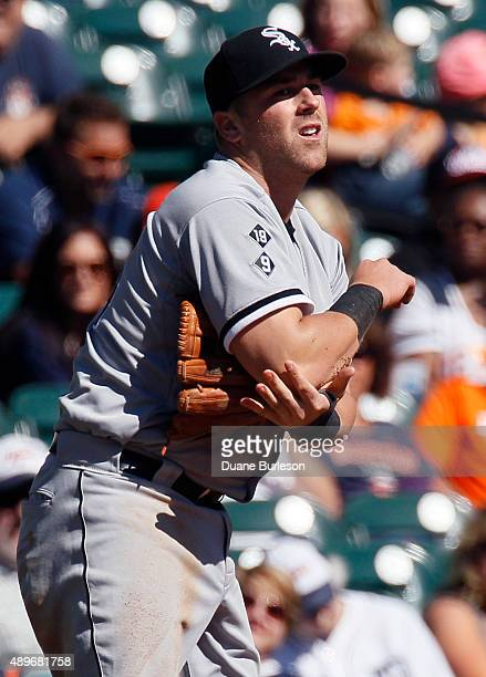 Third baseman Mike Olt of the Chicago White Sox grabs his right arm after trying to field a single by Ian Kinsler of the Detroit Tigers during the...