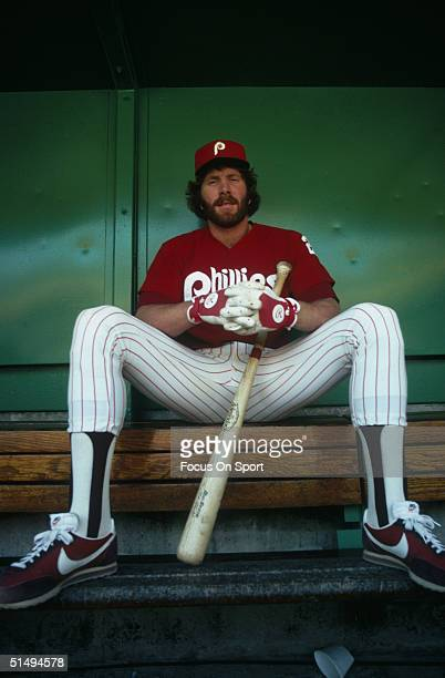Third baseman Mike Schmidt of the Philadelphia Phillies poses in the dugout at Veterans Stadium he led the National League with 48 home runs during...