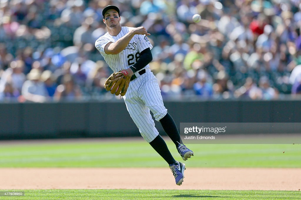 Third baseman Nolan Arenado #28 of the Colorado Rockies makes a throw on the run for the first out of the seventh inning against the Milwaukee Brewers at Coors Field on June 20, 2015 in Denver, Colorado. The Rockies defeated the Brewers 5-1.