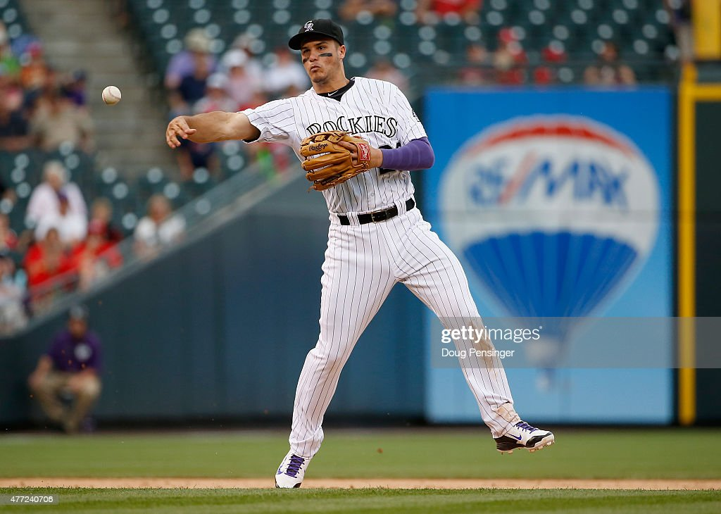Third baseman Nolan Arenado #28 of the Colorado Rockies throws out a runner against the St. Louis Cardinals at Coors Field on June 10, 2015 in Denver, Colorado. The Cardinals defeated the Rockies 4-2.