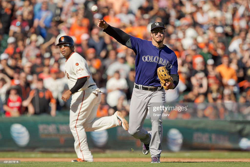 Third baseman Nolan Arenado #28 of the Colorado Rockies throws to first base to end the game against the San Francisco Giants at AT&T Park on October 4, 2015 in San Francisco, California, during the final day of the regular season. The Rockies won 7-3.