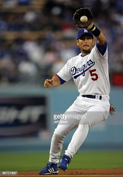 Third baseman Nomar Garciaparra of the Los Angeles Dodgers fields a ground ball by Jason Bay of the Pittsburgh Pirates in the first inning at Dodger...