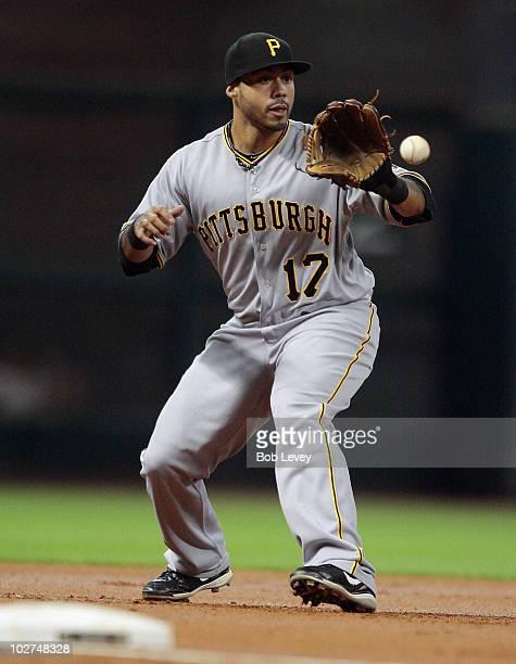 Third baseman Pedro Alvarez fields a ground ball against the Houston Astros at Minute Maid Park on July 8 2010 in Houston Texas