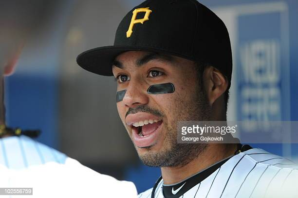 Third baseman Pedro Alvarez of the Pittsburgh Pirates looks on from the dugout before a game against the Cleveland Indians at PNC Park on June 20...