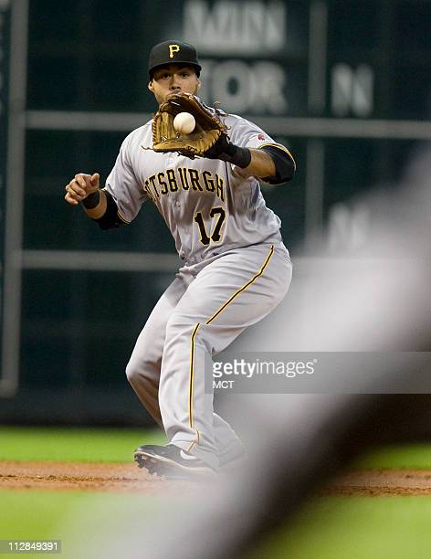 Third baseman Pedro Alvarez of the Pittsburgh Pirates pulls in a ground ball and makes the out on Jeff Keppinger of the Houston Astrosin the first...