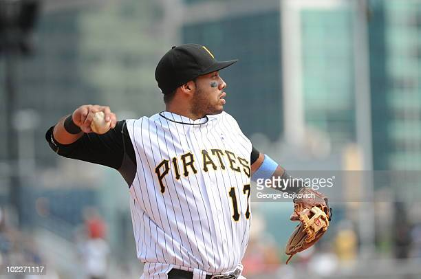 Third baseman Pedro Alvarez of the Pittsburgh Pirates throws to first base while warming up between innings of a game against the Cleveland Indians...