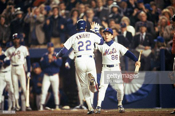 Third baseman Ray Knight of the New York Mets hits a home run and rounds the bases during game 7 of the 1986 World Series against the Boston Red Sox...