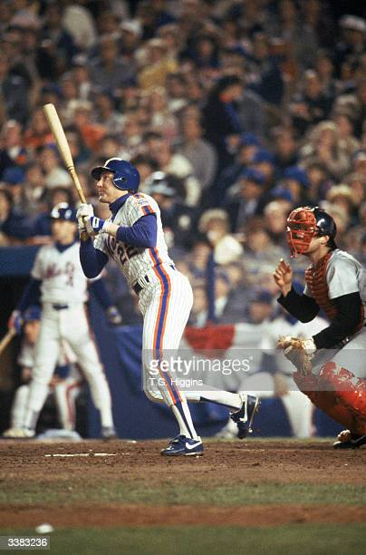 Third baseman Ray Knight of the New York Mets hits a home run during game 7 of the 1986 World Series against the Boston Red Sox at Shea Stadium on...