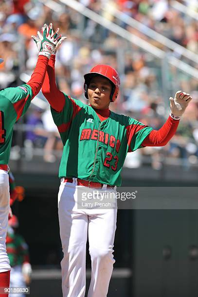 Third baseman Raymundo Berronnes of Mexico celebrates his game winning home run against Texas in the consolation game at Volunteer Stadium on August...