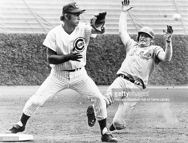 Third baseman Ron Santo of the Chicago Cubs waits for the ball as Rusty Staub of the Montreal Expos slides in during a game at Wrigley Field in...