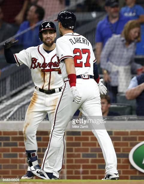 Third baseman Ryan Flaherty of the Atlanta Braves is congratulated by centerfielder Ender Inciarte after Flaherty hits a 3run home run in the fifth...
