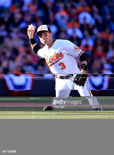 Third baseman Ryan Flaherty of the Baltimore Orioles throws out a Boston Red Sox runner during the sixth inning during Opening Day at Oriole Park at...
