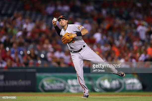 Third baseman Ryan Flaherty of the Baltimore Orioles throws to first against the Los Angeles Angels of Anaheim at Angel Stadium of Anaheim on July 22...