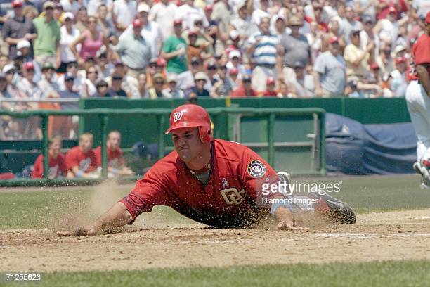 Third baseman Ryan Zimmerman, of the Washington Nationals, slides home safely to score the first run for the Nationals during a game on June 18, 2006...